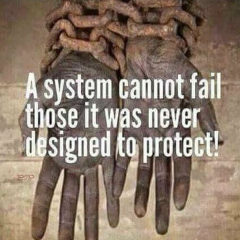 "Text overlaying image of two black hands chained together, palms upward saying ""A system cannot fail those it was never designed to protect."""